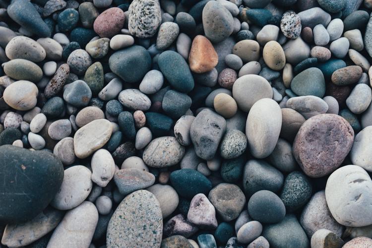 stones sand in car