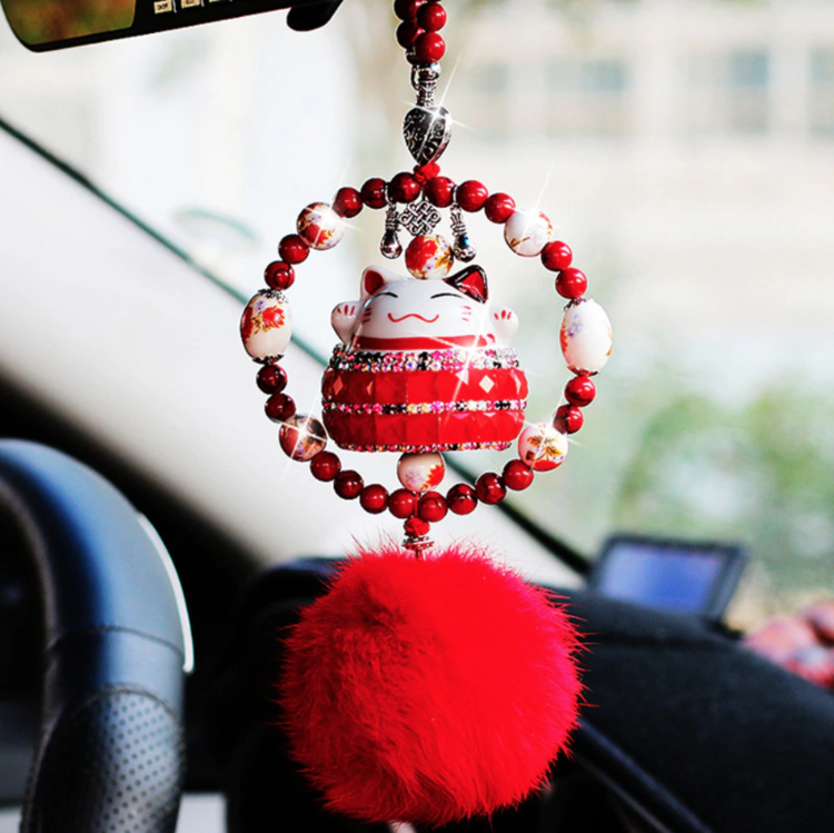 Lucky cat hanging in car